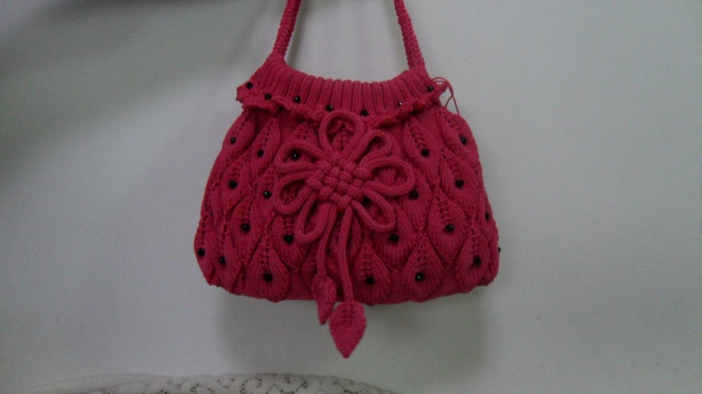 漂亮的包包就是织时候麻烦 高清图片