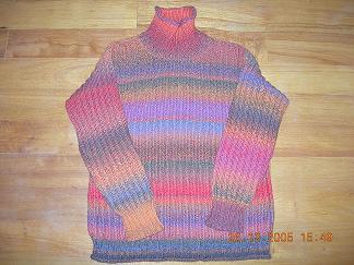 这是前不久才织,毛线是花线,织的花型比较简单