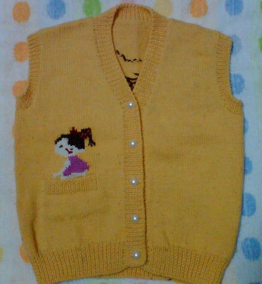 这是黄毛衣剩下的线织的小背心