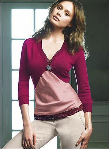 突出女性曲线的款式设计,流露妩媚态度