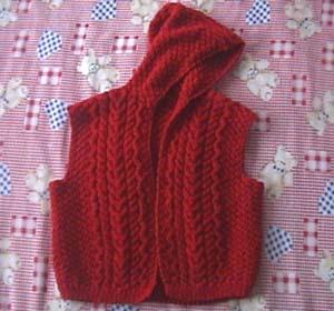 这个是前年织的,本来是毛衣,后来不想织袖子了,就成了背心