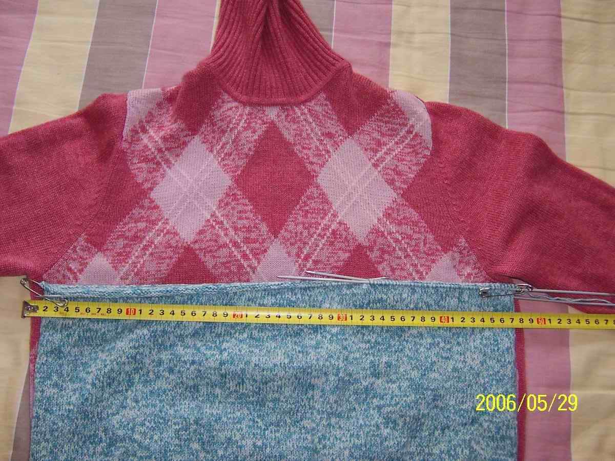 我是按下面的红毛衣大小打的