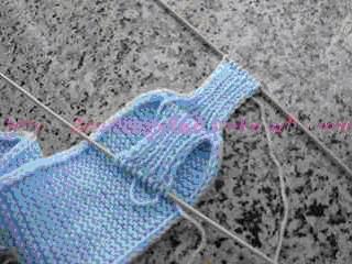 再以一针低一针高/1目松紧编织2,4,6,8,10...的针眼,同样织3cm即停上。