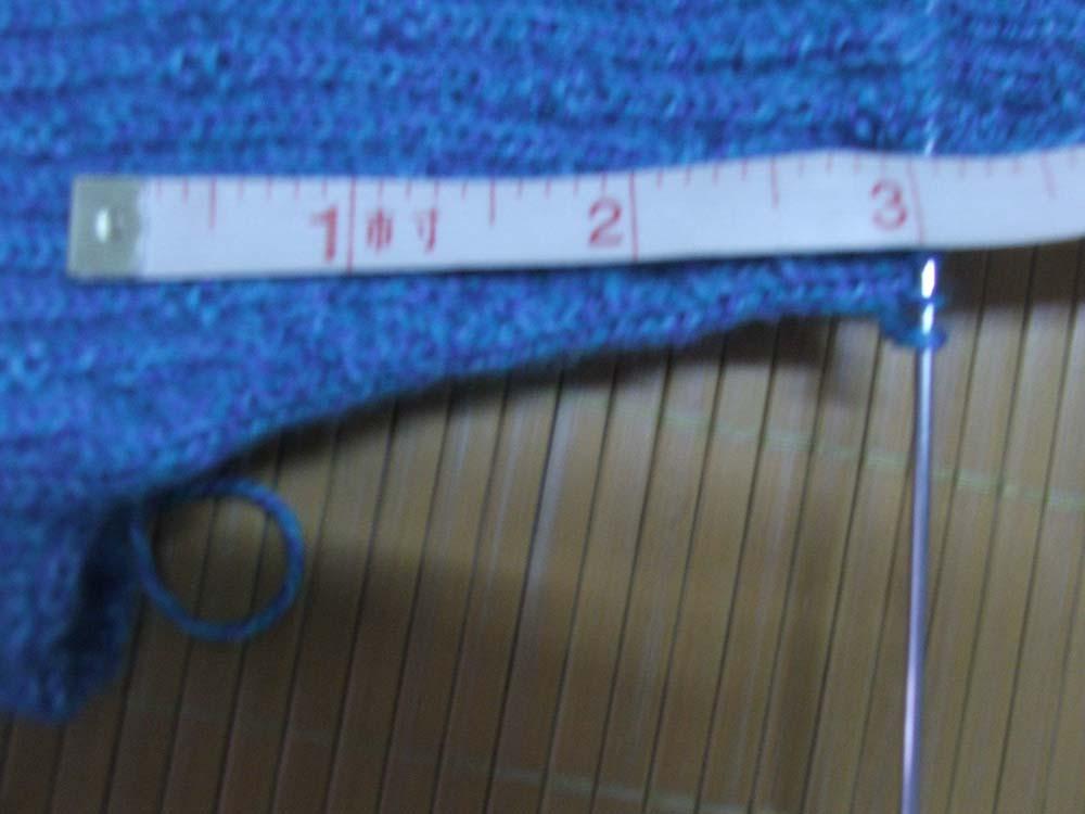 前片织到3寸,余94针
