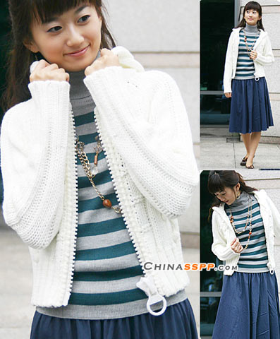 白色针织毛衣是独特之处在于细节的夸张拉链设计,在细腻中追求时尚感,寻找小女生的灵气