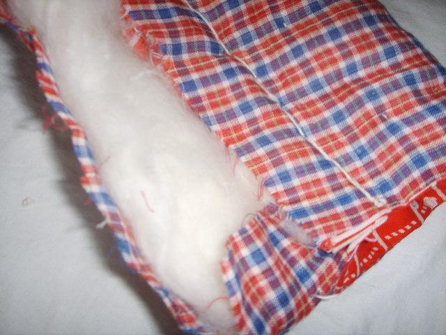 10.把没缝的掀开,把缝好的握在没缝的下面