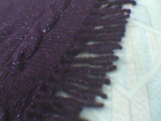 流苏是用钩针钩成的,不用断线。