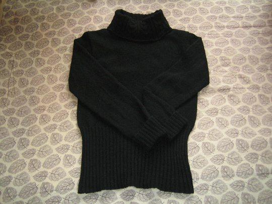 米米的黑色兔毛线织的衣衣